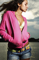 Woman in pink jacket posing for the camera