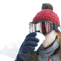 Woman in warm clothing enjoying a cup of hot drink