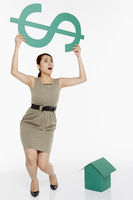 Woman lifting up a dollar sign