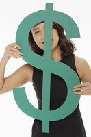 Woman looking through a dollar sign