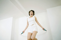 Woman playing with skipping rope