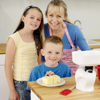 Woman posing with boy and girl in the kitchen