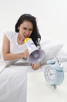 Woman shouting at the alarm clock