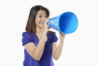Woman shouting into a megaphone