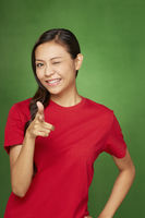 Woman smiling and pointing towards the camera