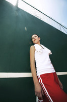 Woman standing in the tennis court