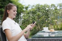 Woman text messaging on phone