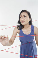 Woman trapped in between tangled wires