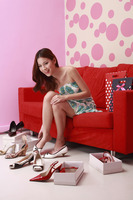 Woman trying on different kinds of high heels