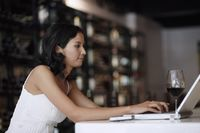Woman using laptop at the bar