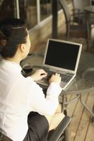 Woman using laptop in a cafe