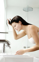 Woman washing her hair on the basin