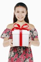 Woman with a box of wrapped gift