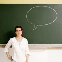 Woman with a speech bubble on the blackboard