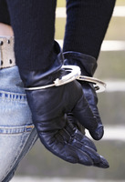 Woman with her hands handcuffed to the back