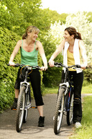 Women chatting while sitting on bicycles