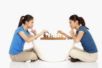 Women playing a game of chess