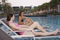 Women relaxing on lounge chairs