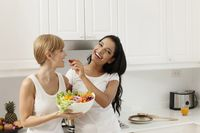 Women sharing a bowl of salad