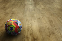 World flags soccer ball on parquet floor