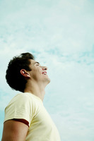 Young man laughing while looking up