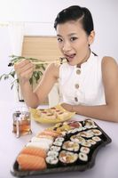 Young woman enjoying japanese cuisine