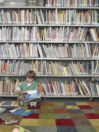 Children : Boy with picture books