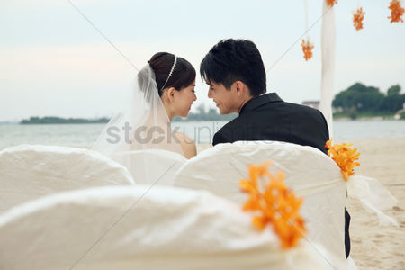 Celebration : Bride and groom at their beach wedding ceremony
