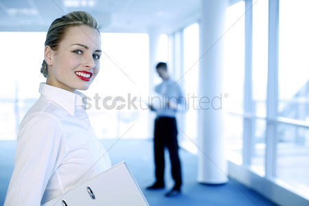 Environment : Businesswoman flashing a wide smile at the camera