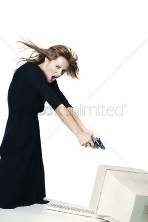Business : Businesswoman pointing her pistol at a computer monitor