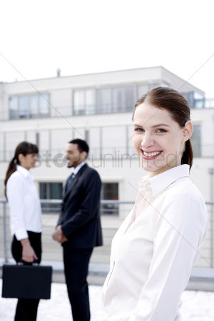 Environment : Businesswoman smiling at the camera