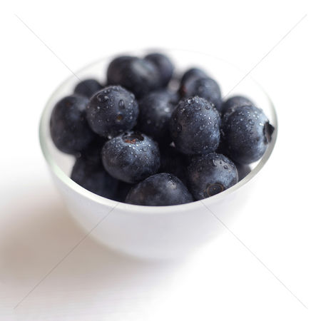 Background : Close up of some blueberries in a bowl