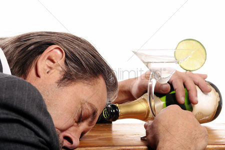 Celebration : Drunk businessman sleeping on the table