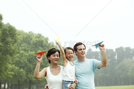 Children : Family of three with paper planes