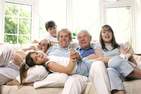 Girl : Group shot of a family spending time together in the living room