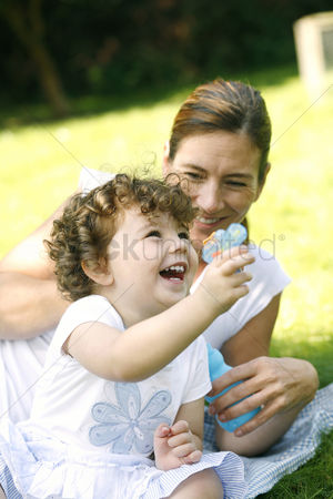Park Outdoor : Mother and daughter having fun in the park