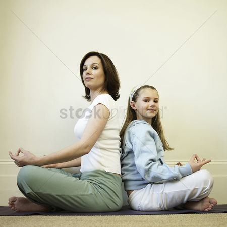 Girl : Mother and daughter practicing yoga