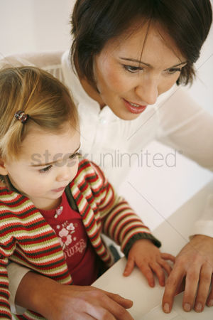 Girl : Mother and daughter using laptop