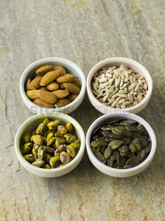 Food : Nut and seed selection in four bowls