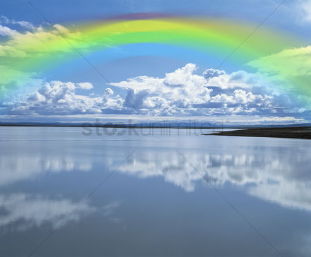Environment : Rainbow over calm lake