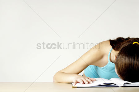 Business : Woman with her head on the book