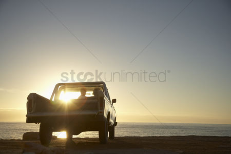 Romantic : Young couple in van parked in front of ocean