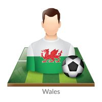 Wales player with soccer ball on field