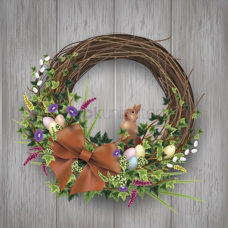 Greetings : Easter egg wreath on wooden background