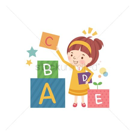 School children : School girl stacking alphabet cubes