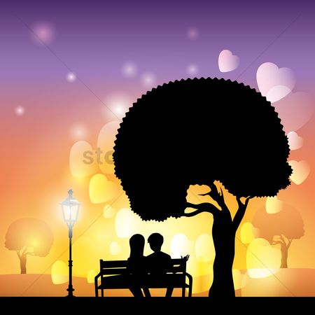 Lamp : Silhouette of couple sitting on bench