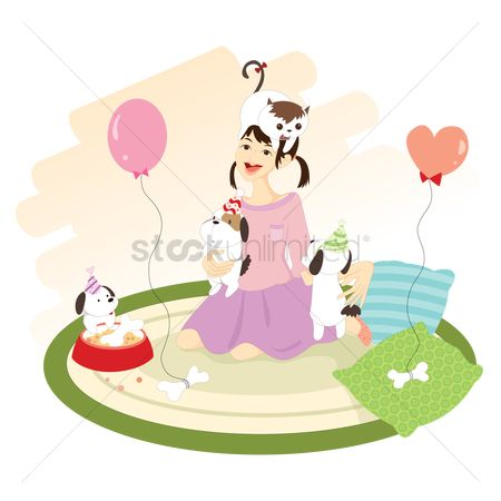 Lifestyle : Woman playing with cat and dogs