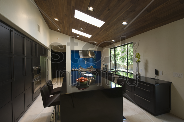 black gloss kitchen with skylights stock photo
