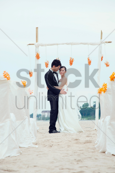 bride and groom at their beach wedding ceremony stock photo