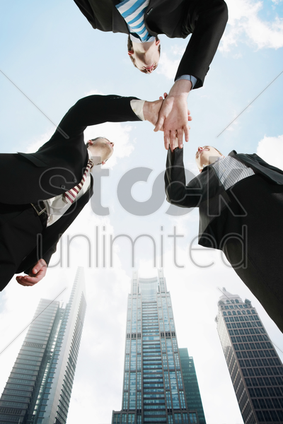 business people with hands together stock photo